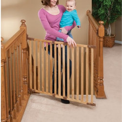 KidCo - KidCo Angle Mount Wood Safeway Gate - Oak - G2300 - Shop for Safety Gates from Hayneedle.com! The KidCo Angle Mount Wood Safeway Gate - Oak is a smart and safe solution for any stairwell without two mountable walls. Crafted from durable steel material this secure swinging gate helps prevent accidents around your home and keeps your child safe from dangerous environments. The secure-latch design features a directional stop that won't swing open over your stairs. Quick-release hardware features hinge-side materials that can be mounted at an angle to adapt to any space and the one-hand gate opens and closes easily (for adults). The bottom rail is attached to the gate so there's nothing to trip over when the gate is open.About KidCoIncorporated in 1992 KidCo specializes in the designing engineering and production of upscale products for juvenile pet and fireplace markets. The pressure-mounted safety gate was a completely new concept that put KidCo on the map and has since been the cornerstone of their business. KidCo offers a comprehensive assortment of child home safety products ranging from cabinet locks to TV straps and much much more. Located in Libertyville IL their state-of-the-art distribution and administration systems ensure that KidCo fulfills their customers' needs and expectations in an efficient and timely manner. Today KidCo personnel still personally ensure the highest level of customer service to both dealers and end consumers.