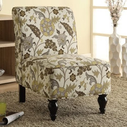 Monarch Floral Traditional Accent Chair - Brown / Gold - Classic yet contemporary, the Monarch Floral Traditional Accent Chair - Brown / Gold makes a designer statement in your room. As stylish as it is comfortable, this chair features plus cushioning and is upholstered in a brown and gold floral that is never boring. It has a modern armless design, tailored trim detail, and elegant turned wood legs in a glossy black finish. About Monarch InternationalMonarch International Inc. is a leader in home style products manufactured from metal, and combinations of wood and glass. Their roots lie in manufacturing metal badges and buttons for the Indian Army. From there, they evolved and diversified into other products and Monarch started selling hand-crafted goods and lifestyle accessories in the United States and other global markets. Their corporate policy is based on the principles of partnership, trust, service and an unwavering commitment to quality products.