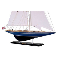 Handcrafted Nautical Decor - Velsheda Limited 35'' - NOT A MODEL SHIP KIT--Attach Sails and Velsheda model yachts are Ready for Immediate Display--Brightening any room with their presence, these Limited Edition sailing ship models of the famous J-class Cup racing yacht Velsheda radiate the unbound freedom of the wind, graceful speed of the waves and winning spirit of their famous namesake.From atop a table, mantle or shelf, these elegant model yachts sail proudly as the perfect highlight for any beach house or bedroom, meeting room or office.--35'' High x 4'' Wide x 27'' Long (1:58 scale)----    Individual plank      on frame      construction of the hull using fine quality woods, with each plank and      wood grain visible through the paint--    High quality Craftsmanship and Details, including:--    --        Clear window panes in all       deckhouses--        Brass wire railing running       along gunwales--        Accurate scale of deck and       hull components--        Finely stitched sails with       quality rigging--    --    --    Limited      production run only 100 of this model sail boats--    Certificate      of Authenticity individually numbered and signed by HMS Founder and Master      Builder Richard Norris--    Significant      research to guarantee accuracy of this model yacht includes sources such as photos,      historical plans and original artwork--    Pre-assembled, simply attach the masts and      display--    --        Ready to display in less than       five minutes--        Separate pre-assembled hull       and sails ensure safe shipping and lower cost--        Insert mast in designated hole       and clip brass rigging hooks as shown in illustrations--        Sails and rigging already       complete--    --    --