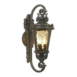 """John Timberland - Traditional Casa Marseille™ 21 1/2"""" High Outdoor Wall Light - The allure and romance of the Mediterranean landscape beckons with this handsome outdoor wall light. From the John Timberland™ lighting collection it comes in a handsome veranda bronze finish. With champagne hammered glass that offers an antique look. A wonderful design for entry spaces garage areas and more. Uses three 40 watt candelabra bulbs (not included). 21 1/2"""" high 9"""" wide. Extends 10 1/2"""" from the wall. Backplate is 16"""" high 5 1/2"""" wide. Mounting point to top of fixture is 10 1/2"""".  Veranda bronze finish.  Champagne hammered glass.  From the John Timberland lighting collection.  Uses three 40 watt candelabra bulbs (not included).  21 1/2"""" high and 9"""" wide.  Extends 10 1/2"""" from the wall.  Backplate is 16"""" high 5 1/2"""" wide.   Mounting point to top of fixture is 10 1/2""""."""
