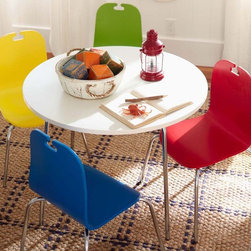 Avery Table And Chairs - Add whimsy to your dining room with different colored chairs for the kiddos.