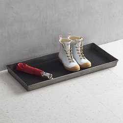 Zinc Boot Tray with Liner - Keep it clean with this high-functioning and decorative boot and shoe tray crafted in cool zinc with a durable, vulcanized rubber liner. Slim profile stays out of the way; textured liner speeds up drying time for wet and soiled footwear.