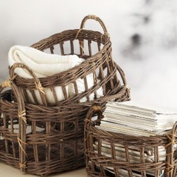 Open-weave Vine Baskets - These rustic baskets are great for just about anything: towels for guests, shoes by the front door or throw pillows next to the sofa.