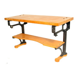 Vintage Industrial Butcher Block Work Bench - This completely authentic work table / workbench comes straight from a long-shuttered New England textile mill. The fabulous graphic look of the cast iron stanchions is complimented by the thick solid maple butcher block top, which proudly displays signs of its age and history.
