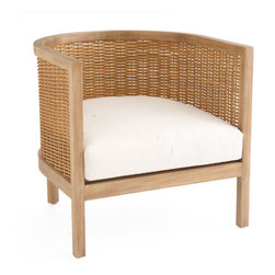 """Woven Rattan Club Chair - Somehow white upholstery always says """"beachy,"""" despite it's unnatural place next to sandy feet and wet bathing suits. But white slipcovers are good compromise for the high-use pieces and look extra crisp next to blonde rattan."""