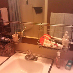 Hayesdo - Bathroom mirror with IKEA Bygel rail and baskets...$6 total!!