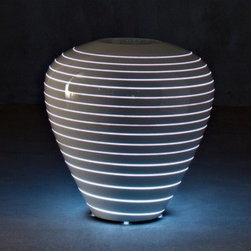 Grand Mary Outdoor Pot with Light by Serralunga - Grand Mary Outdoor Pot with Light by Serralunga for indoor and outdoor areas, featuring curvy spiral engravings on the surface. One with a more rigorous shape and the other softer and curvy. An object that transcends the concept of a pot to transform into an extremely versatile item of furniture. Grand Mary Outdoor Pot with Light by Serralunga are designed by Marc Sadler.