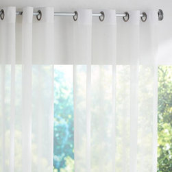 Indoor-Outdoor Sheer Grommet Drape - Nothing brightens up a room like white, so replace your heavy drapes for some sheer white curtains this summer.