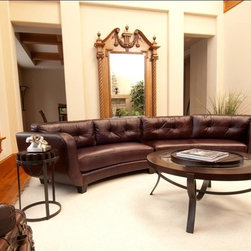 Elements Home Furnishing - Vittorio Top Grain Leather Sectional in Mahog - Left Arm Facing Loveseat and Right Arm Facing Loveseat. Shown in Mahogany. Top Grain Leather. Track arm. Tufting on back cushions. Back cushions are sewn in and not removable. Hardwood frame encased in  high density foam. Dark wood feet. Left Arm Facing Loveseat Dimensions: 81.5 in. D x 39 in W x 34 in. H ( 112.2 lbs. ). Right Arm Facing Loveseat Dimensions: 81.5 in. D x 39 in W x 34 in. H ( 112.2 lbs. )Graceful fluidity is realized in the curvatures of the Vittorio Collection.  This à la mode design is inspired by the stylish silhouettes found in modern Italian furnishing concepts.  The beautifully tufted boxed cushions include piping along the outside edges while the smooth seat cushions cater to your every whim.  The charming round edges of the track arms pick-up where the curvatures of the base, sides and back left off, a perfect interception of inertia. Sturdy wood block feet were chosen for this half moon shape and provide ultimate support.  Upholstered in top grain leather shown in Mahogany, this sectional expresses classiness and tasteful confidence.