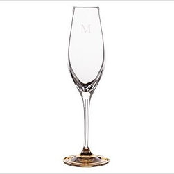 """Caroline Flute Glass, Set of 6, Gold - Toast the festivities with our elegant glassware, part of our new Caroline Registry Gift Collection. Master glassblowers in Poland create our delicate yet durable pieces, notable for their gold and silver bases. We've wrapped them in a beautiful gift box so they're ready to present on that special occasion. White Wine: 3"""" diameter, 9.5"""" high; 6 fluid ounces Red Wine: 3.5"""" diameter, 9.5"""" high; 10 fluid ounces Flute: 3"""" diameter, 10"""" high; 7 fluid ounces Made of blown glass. Set of 6. Hand wash. Monogramming is available at an additional charge. Gold is Catalog / Internet only. Packaged in a beautiful PB storage box. Made in Poland. Read more on our blog about the inspiration behind this product."""