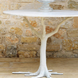 White Faux Bois Dining Table - The asymmetry of the roots creates an ever-visible surprise in the clean-lined, classic design of the White Faux Bois Dining Table.  Ideal for a whimsical breakfast nook or a dining room with woodland flair, the round table with its slim sapling pedestal rests its top on a beautifully expressive sculpture of a leafless forest tree, its shapely naturalness bringing a bright, romantic fantasy to your home.
