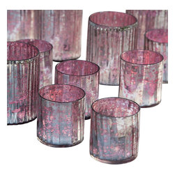 Blush Votives - Washed in antique-silver, the Blush Votives pack a soft glow year-round. From the flush of summer to the rosy chill of winter, use the Blush Votives as an accent in any room. They are great for small blooms or ambient flame.