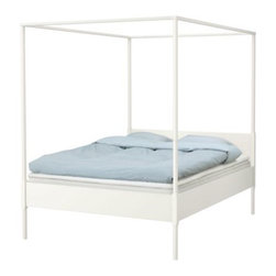 Nike Karlsson/IKEA of Sweden - EDLAND Four-Poster Bed Frame - Made of solid wood, this bed is meant to last. I love the white color and the four-poster bed frame can be dressed up.