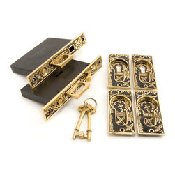 Leaf Double Pocket Door Mortise Lock - Privacy - Blackened Brass - This double pocket door mortise lock is embellished with a detailed leaf design that will give your home an extra touch of style. A convenient push button activates the finger grip when the doors are recessed into their openings.