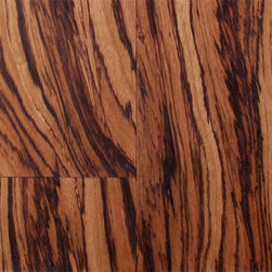 Exotic Wood Flooring - Heartwood is a light brown or cream color with dark blackish brown streaks vaguely resembling a zebra's stripes. Depending on whether the wood is flatsawn or quartersawn, the stripes can be either chaotic and wavy (flatsawn), or somewhat uniform (quartersawn).