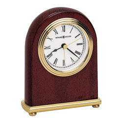 Howard Miller - Howard Miller Rosewood Arch Mantel Clock - Howard Miller - Mantel / Table Clocks - 613487 -This contemporary mantel clock reflects simple elegant style and is as well-suited to any shelf or desk/counter as it is to a mantel. Distinguished by its warm wood arch frame, white dial with brass triple rim and bezel and matching brass base, the Rosewood has a casually refined character sure to be appreciated. Battery operated quartz movement and a rosewood hall finish round out the look and appeal of the Rosewood Arch Mantel Clock.