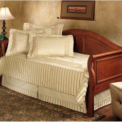Hillsdale Furniture - Bedford Daybed - HL1062 - Shop for Daybeds from Hayneedle.com! What an elegant daybed for your guest room or even your own room! The Bedford Daybedis crafted of sturdy Asian hardwood and is finished in traditional cherry. You'll appreciate the intricately carved raised panels on the back and sides and the sleigh style adds warmth and character. Antique looking rosettes adorn the sides of this daybed. This bed is available in a number of options. A beautiful choice for your home. A trundle is an extra mattress frame stored beneath a daybed which slides out to provide additional sleeping space when needed. Daybeds.com optional trundle packages include a metal pop-up style trundle. They can be left in the lowered position or elevated in the pop-up position to align with the primary daybed mattress. The pop-up feature allows the daybed to transform from a twin size daybed into a king size bed. Creating a king size bed out of a daybed and a pop-up trundle is easy and with the Create-A-King mattress connector it will be so comfortable you'll never know it comprises two twin mattresses. The Create-A-King isn't necessary for the tranformation but is an excellent way to cover the seam between the two twin mattresses. The Create-A-King mattress connector is available for purchase in the shopping cart. Optional mattress is the Orthopedic Back Aid Mattress. Constructed with durable springs surrounded by padded layers the Orthopedic Back Aid Mattress will help ease you into sleep each night. This quality mattress features a Sta-rite quilted cotton/polyester pad and a patented Aerolife bonded cotton pad made with high-performance fibers that extend the life of the mattress. Rolled inner spring coils take the pressure off your back while a Damask quilted layer on one side enhances your comfort. Twin size measures 75L x 39W x 7.5H inches. Carries a three-year manufacturer's warranty. About Hillsdale FurnitureLocated in Louisville Ky. Hillsdale Furniture is a l