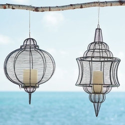 Wire Lanterns - These caged wire sculptures will add a whimsical touch to any outdoor environment.