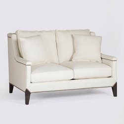 Liam Settee - Designed with a vintage feel, our Liam Settee makes a beautiful addition to any living room. It features slim arms, plush removable cushions and exposed wooden legs for a classic, tailored look.