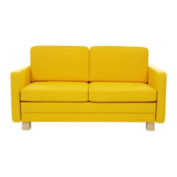 Artek Sofa-bed - This bright, sunny yellow sofa would be the star in any room.  It's like a giant, happy face lighting up a room.  This cheerful sofa is hiding a secret...it's can turn into a bed when needed, too!