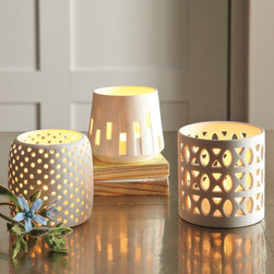 Porcelain Candleholders - Beautiful little votive holders light up the table when dinners go long.