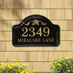 """Frontgate - Acanthus Arch Address Plaque - Handmade ceramic plaque with cast aluminum acanthus detail. Personalize your own with classic numbers and letters (gold on black plaque and bronze on white plaque). Select up to five 3"""" high numbers for the first line. Select up to 17 1"""" high characters for the second line. Crafted for outdoor display. Personalize your entry and display your address in large numbers with our customized Acanthus Arch Address Plaque. This elegant plaque is handcrafted from ceramic, and adorned with an acanthus leaf emblem under the arch. . . . . . Arrives ready to hang. Clean with a soft cloth as needed. Made in the USA. Please check for accuracy; personalized orders cannot be modified, cancelled, or returned after being placed."""