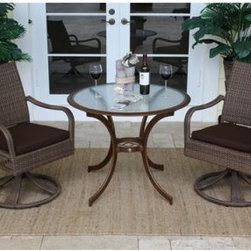 "Hospitality Rattan Grenada 3 Piece Swivel Dining Bistro Set - Viro Fiber Antique - Approach conversation from every angle in the Hospitality Rattan Grenada 3 Piece Swivel Dining Bistro Set - Viro Fiber Antique Brown's smooth-swiveling chairs. The Grenada Collection has a modern, tropical feel that offers a clean look for any patio area - not to mention the convenience of all-weather wicker. This set's two rocking chairs are each supported by a sturdy swiveling base and an aluminum frame wrapped in high quality antique brown Viro fiber. High backs offer supreme comfort and decorative open weaving along the sides of each seat is light and airy. The dark bronze aluminum table boasts dramatically curved legs, an artful center support, and a clear tempered glass top.DimensionsChairs: 24L x 29W x 36H inchesTable: 36 diam. x 29H inchesAbout Hospitality Rattan Hospitality Rattan has been a leading manufacturer and distributor of contract quality rattan, wicker, and bamboo furnishings since 2000. The company's product lines have become dominant in the Casual Rattan, Wicker, and Outdoor Markets because of their quality construction, variety, and attractive design. Designed for buyers who appreciate upscale furniture with a tropical feel, Hospitality Rattan offers a range of indoor and outdoor collections featuring all-aluminum frames woven with Viro or Rehau synthetic wicker fiber that will not fade or crack when subjected to the elements. Hospitality Rattan furniture is manufactured to hospitality specifications and quality standards, which exceed the standards for residential use. Hospitality Rattan's Environmental Commitment Hospitality Rattan is continually looking for ways to limit their impact on the environment and is always trying to use the most environmentally friendly manufacturing techniques and materials possible. The company manufactures the highest quality furniture following sound and responsible environmental policies, with minimal impact on natural resources. Hospitality Rattan is also committed to achieving environmental best practices throughout its activity whenever this is practical and takes responsibility for the development and implementation of environmental best practices throughout all operations. Hospitality Rattan maintains a policy of continuous environmental improvement and therefore is a continuing work in progress. Hospitality Rattan's Environmentally Friendly Manufacturing Process All of Hospitality Rattan products are green. From its basic raw materials of rattan poles, peels, leather, bamboo, abaca, lampacanay, wood, leather strips, and boards, down to other materials like nails, staples, water-based adhesives, finishes, stains, glazes and packing materials, all have minimum impact to the environment and are safe, biodegradable, recycled, and mostly recyclable. Aside from this, the products have undergone an environmentally-friendly process that makes them """"greener."""" The company's rattan components are sourced from sustained-yield managed forests, which means the methods used to grow and harvest the rattan vines ensure the long-term life of the forest and protect the biodiversity of the forest's ecosystems. Hospitality Rattan is committed to buying and using all materials, from rattan and hardwood to finishing materials, from reputable and renewable suppliers and seeks appropriate evidence that suppliers are in compliance with this policy. Hospitality Rattan strives to use materials that are processed in an environmentally responsible manner, or consist of a high level of recycled material. Finishing materials and stains used in Hospitality Rattan's furniture products consist of 75% water-based solutions which evaporate upon application with reduced or Volatile Organic Compounds (VOCs). The furniture factories use water-based glues, stains, topcoats and other finishes on all of their products. The switch from traditional solvent-based processes to water-based processes involved consolidating several processes by the factories, resulting in an 85% reduction in VOC emissions."