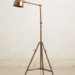 Tripod Floor Lamp - Placed next to your favorite button-tufted respite, this three-legged floor lamp puts a modern twist on vintage charm.