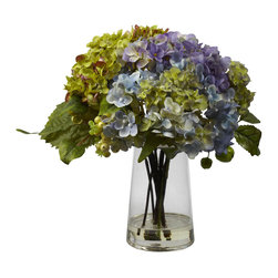 "Nearly Natural - Hydrangea with Glass Vase Arrangement - Beautiful, full, and lush, this large (11"" high) Hydrangea arrangement will fill any area with color, without overwhelming it. That's the beauty of these flowers - soft yet striking, which makes it the ideal complement to almost any decor. Perfect for a kitchen, dining area, or anywhere else that needs just a bit of life. Comes complete with an attractive glass vase filled with liquid illusion faux water. Height: 11 In.; Width: 10 In.; Depth: 10 In.; Pot Size: H: 6 In. W: 3.5 In. D: 3.5 In."