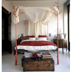 Twig Bed - Cotton Muslin Draped Canopy Bed made from sustainable wood twigs.
