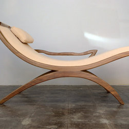 Victor - The Victor is known for it's perfect bisecting of gentle curves.   Expertly carved to enhance the inherent beauty of the materials this piece is part practicality and part sculpture. Every aspect of the design was engineered for comfort from the adjustable pillow to the gentle curve of the armrest.
