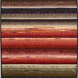 "Quilts--abstract and intense - A jazzy quilt that employs very tiny strips of cotton fabric to create an undulating feeling of motion and depth ans dawn gradually appears. About 36 x 45"". Each quilt in this series is different and can be made in custom colors. Yes, the strips really are 1/4 inch wide. Photo by John Polak"