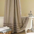 Ticking Stripe Ruffled Shower Curtain - Adding a bit of extra fabric to your shower curtain is always a little extra indulgence. I love the light ruffle detail on these beautiful striped shower curtains!