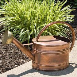 Large Oval Hammered Copper Watering Can - This Large Oval Hammered Copper Watering Can features a ribbed design with a lightly hammered Antique Copper body and smooth Aged Brass spout.