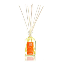 Orange Blossom, Lilac & Jasmine Diffuser 250 ml. - Dazzle your guests with the warm, feminine purity of the Orange Blossom, Lilac, and Jasmine Diffuser's exotic yet mellow and lingering home fragrance.  Birch reeds rest in the mouth of a vintage-style glass apothecary bottle to draw this wonderful mingling of aromatic favorites into the air.  The romantic, fruity scent is given delicious complexity by undertones of soft white musk.