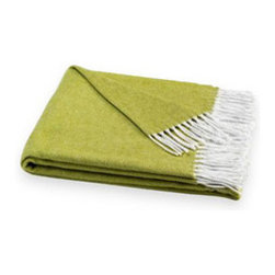 Soft Lemongrass Throw - This Soft Lemongrass Throw creates a sophisticated yet cozy look in any room. Made from a 50% cotton, 50% acrylic blend, the throw feels cashmere-soft and is versatile enough to drape over the sofa or bed's end. The throw's lemongrass color throws the space a color splash yet remains completely classic and stylish. Italian-made, the accent piece can be used throughout the seasons, year round.