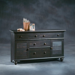 """Sauder - Harbor View 4 Drawer Dresser - This dresser has a perfect easy-living cottage look and is an eclectic piece of graceful yet simple detailing that is highlighted by an antiqued paint finish. Features: -Four drawers with metal runners and safety stops.-Additional storage behind detailed cabinets.-Solid Wood Construction: No.-Powder Coated Finish: No.-Gloss Finish: No.-Non Toxic: Yes.-Scratch Resistant: No.-Storage Function: Clothing.-Drawers Included: Yes -Number of Drawers: 4.-Drawer Interior Finish: Wood.-Drawer Glide Material: Metal.-Soft Close or Self Close Drawer Glides: Yes.-Safety Stop: Yes.-Ball Bearing Glides: Yes.-Joinery Type: Twist lock.-Drawer Dividers: No.-Felt Lined Drawers: No.-Drawer Handle Design: Knob..-Clothing Hooks Included: No.-Clothing Rod Included: No.-Foot Design: Bun.-Cabinets Included: Yes -Number of Cabinets: 2.-Adjustable Interior Shelves: No.-Number of Doors: 2..-Hidden Storage: No.-Interchangeable Panels: No.-Mirror Included: No.-Hutch Included: No.-Finished Back: No.-Distressed: Yes.-Collection: Harbor View.-Swatch Available: Yes.-Commercial Use: No.-Country of Manufacture: United States.-Eco-Friendly: Yes.-Product Care: Damp Cloth.Specifications: -FSC Certified: Yes.-EPP Compliant: Yes.-CPSIA or CPSC Compliant: Yes.-CARB Compliant: Yes.-JPMA Certified: No.-ASTM Certified: Yes.-ISTA 3A Certified: Yes.-PEFC Certified: Yes.-General Conformity Certificate: Yes.-Green Guard Certified: No.Dimensions: -Overall Height - Top to Bottom: 33.75"""".-Overall Width - Side to Side: 58.25"""".-Overall Depth - Front to Back: 17.625"""".-Overall Product Weight: 149 lbs.Assembly: -Assembly Required: Yes.-Tools Needed: Hammer and phillip's screwdriver.-Additional Parts Required: No.Warranty: -Product Warranty: 5 years."""