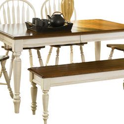 Liberty Furniture - Liberty Furniture Low Country Sand 76x38 Rectangular Leg Table - Welcome the refreshing designs of the Low Country collection into your home. With the simple elegance of gracious turned legs and flowing curves, this collection is sure to make a sophisticated statement. This collection features gathering height, formal, and casual dining groups. Select hardwoods and cherry veneers are offered in a Linen Sand with Suntan Bronze accents. What's included: Dining Table (1).