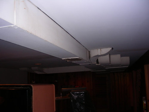 exposed painted hvac ductwork in basement family room
