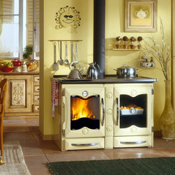 """Wood Burning Cook Stove by La Nordica - Wood burning cook stove """"America"""" by La Nordica. Cast iron body and cooktop, huge baking oven, made in Italy, large see-through firebox."""
