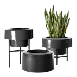 Pad Outdoor - Pod Version 1.0 Spun Aluminum Planter - Indoors or Out, Black, Half Skirt - The traditional planter gains a whole new personality with the contemporary Pod Version 1.0 Full and Half Skirt Planters. Produced in hand spun aluminum, these planters are powder coated, making them durable enough for indoors and out. Rubber feet at the base protect floors and display surfaces. Rustproof aluminum is easily drilled for drainage, if needed. Offered in seven modern colors. Select from Seafoam, Orange, Yellow, Blue, Red, White or Black. Stand in two different heights offered in white or black (sold separately).