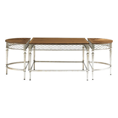 Stanley Furniture - Charleston Regency Trinity Cocktail Table - Champagne Silver Leaf Finish - A metallic apron of braided trellis finished in Champagne Silver Leaf encircles the top of the Trinity Cocktail Table in Clear Walnut. The Cocktail Table is comprised of two demilune-shaped end pieces and a rectangular center section that together form an astragal. The design's multiple pieces allow for practicality and flexibility. One of the demilune sections could be pulled up as a side table for a chair, or pair the two to create an oval table. The base features the same pattern as the Braided Trellis fabric found on the Chippendale Planter's Chair. It is finished in Champagne Silver Leaf that is painstakingly applied by hand. Made to order in America.