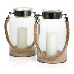 Z Gallerie - Portland Lantern - Understated and relaxed, our Portland Lantern is an attractive way to add candle glow to a room. Inspired by the shape of a jar, our Portland Lanterns glass surrounding protects the candlelight.  Fill with a variety of pillar candle sizes of your choosing and incorporate found objects, or sand for a stunning display. Tall enough to look great on the floor or tabletop, the decorative and sturdy rope handle makes these lanterns easy to transport. Candles not included. Sold separately.