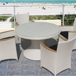 Royal Teak Helena All-Weather Wicker Patio Dining Set - Seats 6 - Wicker doesn't have to be relegated to covered porches and sunrooms any more - the Royal Teak Helena All-Weather Wicker Patio Dining Set - Seats 6 makes wicker a prime player out in the open backyard. This modern outdoor ensemble boasts six deep-seated chairs and a spacious round dining table, each crafted with durable all-weather resin wicker that resists moisture, rot, and wear. You choose the color - black, honey, and white wash are available. The full-weave pedestal table base is topped with a round of inlaid tempered glass you can simply wipe clean. And each full-weave chair is outfitted with smooth teak wood armrests and plush fabric seats in a coordinating shade.