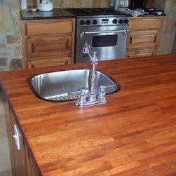 WR Woodworking - Mesquite Edge grain wood counter tops - Mesquite, edge grain center island with vegetable sink.  wrwoodworking.com