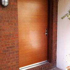 Contemporary Front Doors by Fox Woodworking, LLC