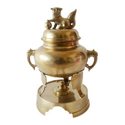 Foo Dog Samovar - A samovar is an urn style pot used to heat water. This foo dog samovar is made of solid brass with a solid brass fuel burner that fits inside the base. Samovar feet are shaped like an elephant head with trunk.
