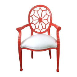 """Used Wheel Back Arm Chair - Tangerine dream! This piece as with all our furniture was found at one of our """"haunts"""". We at Matthew and Company love the hunt for well made vintage furniture from classic design to cottage. We give new life to blah pieces no one wants into pieces people want. This beautiful accent piece has been lacquered and newly upholstered. Perfect accent piece."""