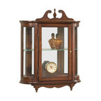 Butler Specialty - Butler Wall Curio - This distinctive wall curio is both functional and beautiful with two adjustable glass shelves and a mirrored back to display your prized possessions. The curved glass sides make it very unique. The glass paneled door features antique brass finished hardware. This future heirloom is made of select solid woods and wood veneers.