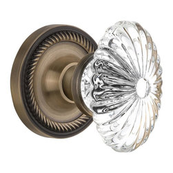 Nostalgic - Nostalgic Privacy-Rope Rose-Oval Fluted Crystal Knob-Antique Brass (NW-712076) - Blending rich detail and subdued refinement, the Rope Rosette in antique brass captures a style that has been a favorite for centuries. Combined with our Oval Fluted Crystal Knob (24 individual hand-ground facets!), the look is elegant, but never fussy. All Nostalgic Warehouse knobs are mounted on a solid (not plated) forged brass base for durability and beauty.